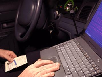 Laptop in Cop Car