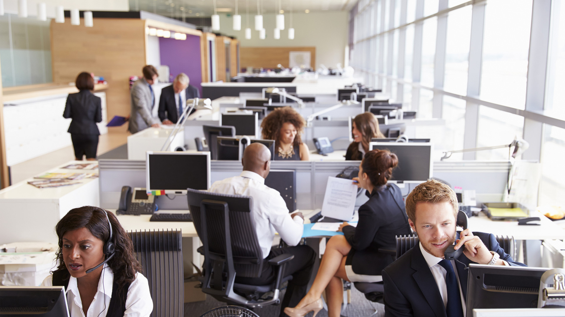 image of office workers on phone for report on EIS contract